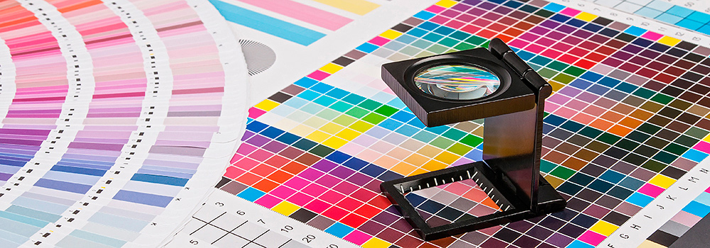 Magnifying glass on top of colour charts